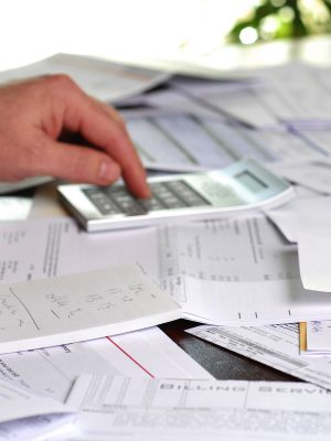 A large amount of bills spread all over the place